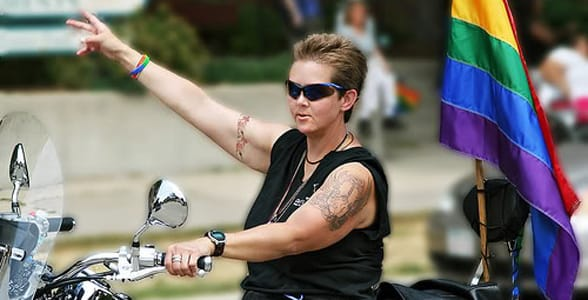 Photo of a butch lesbian on a motorcycle