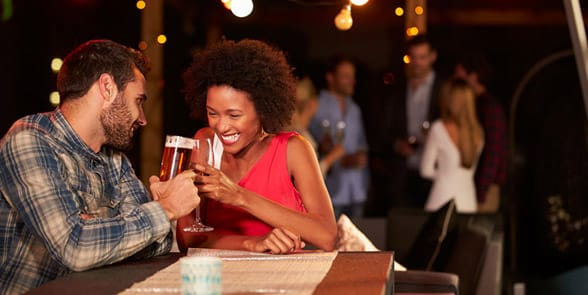 Photo of a couple drinking on a date