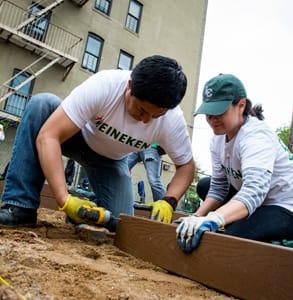 Photo of GrowNYC volunteers building a garden