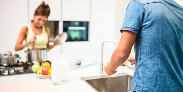 Photo of a couple cleaning together