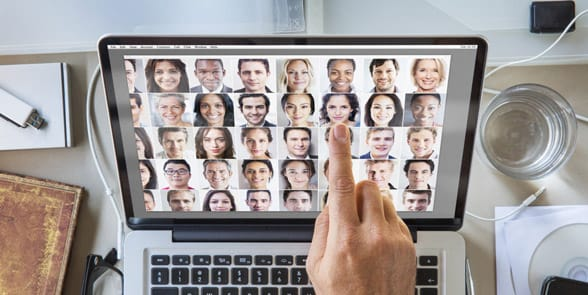 Photo of faces on a computer screen