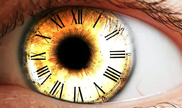Photo of a clock in an eye
