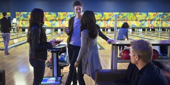 Photo of a couple bowling