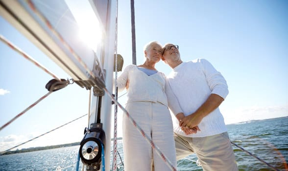 Photo of an older couple sailing