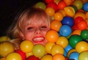 Photo of Becky in a ball pit