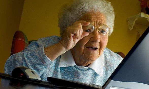 Photo of a grandma using a computer