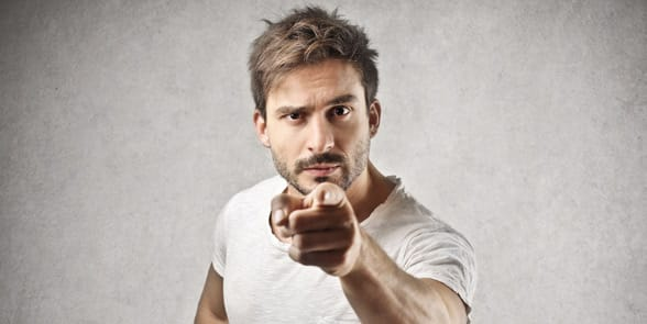 Photo of a man pointing his finger