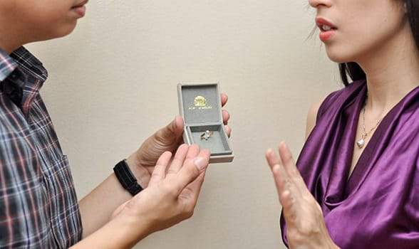 Photo of a woman saying no to a wedding proposal