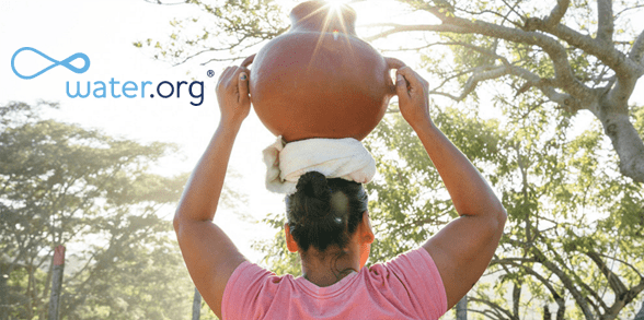 Photo of a woman with jug of water on her head and the Water.org logo