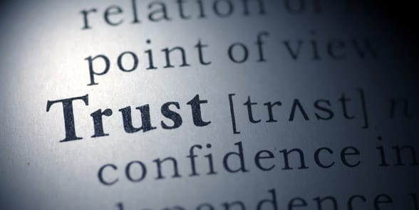 Photo of the word trust in a dictionary
