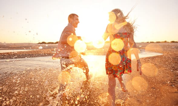 Photo of a happy couple on the beach