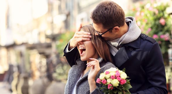 Photo of a boyfriend surprising his girlfriend