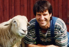 Photo of Gene Baur, Founder of Farm Sanctuary, and Hilda the sheep