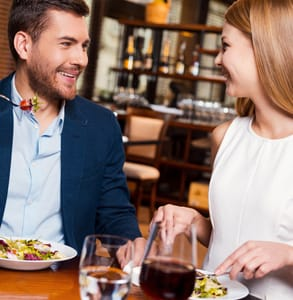 Photo of a couple eating together