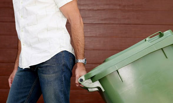 Photo of a man taking the trash out