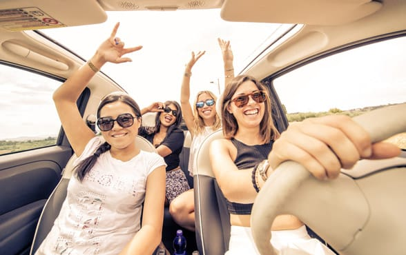 Photo of women on a road trip