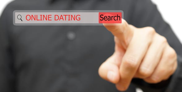 Photo of a guy searching for a dating site