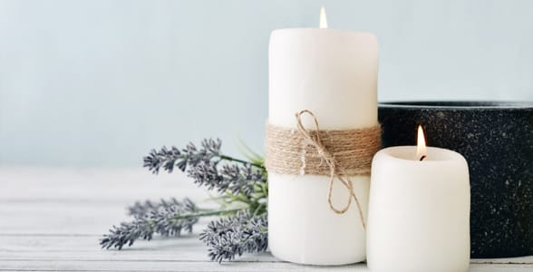 Photo of two candles and lavender