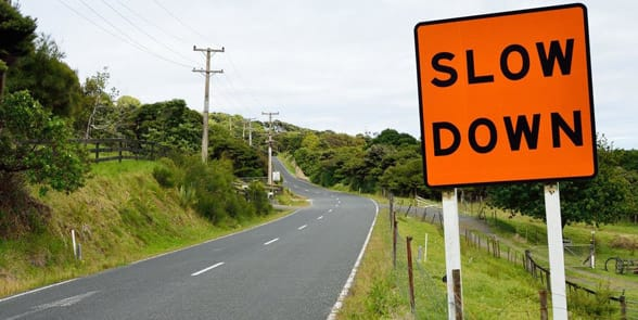 Photo of a slow down sign