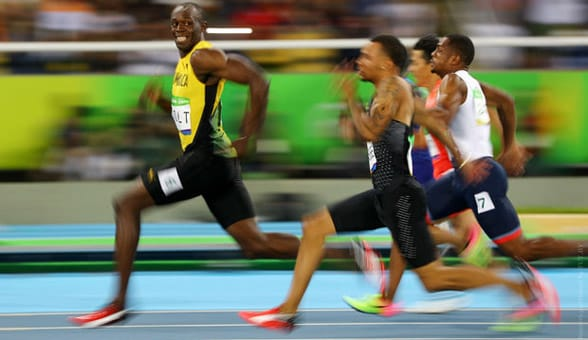 Photo of Usain Bolt coming in first