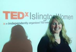Photo of Elizabeth Sullivan giving a TED Talk