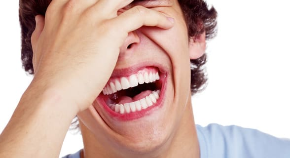 Photo of a man laughing at himself