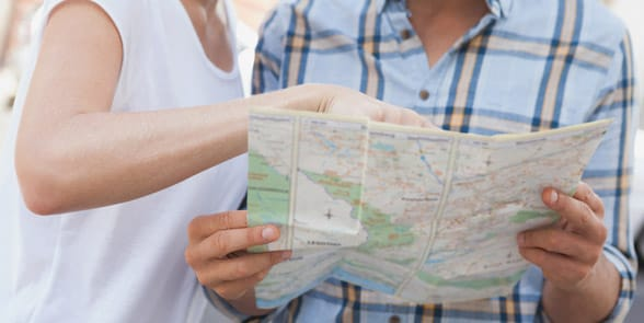 Photo of a couple looking at a map together