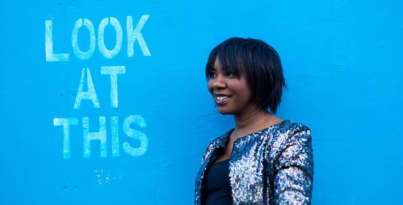 Photo of a woman in front of a blue wall