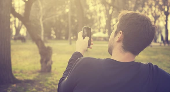 Photo of a man on his phone