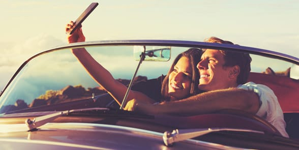 Photo of a couple talking a selfie