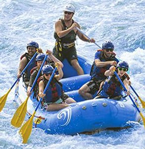 Photo of a group whitewater rafting on the Oklahoma River