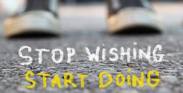 A motivational poster that says stop wishing, start doing