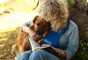 Photo of a shelter volunteer with a dog