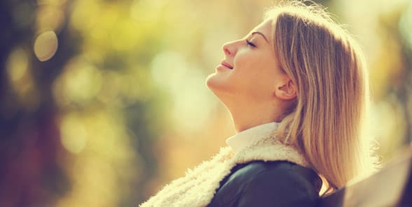 Photo of a woman taking a deep breath