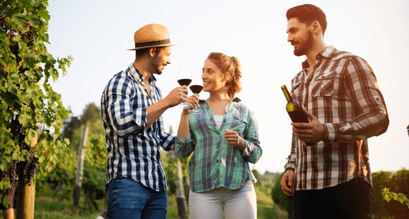 Photo of tour guests enjoying a bottle of wine