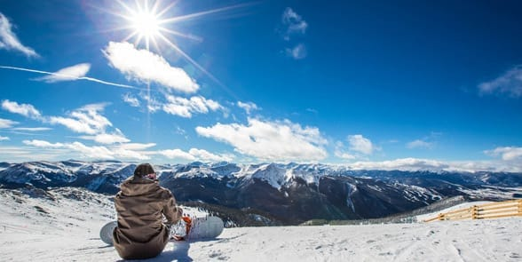 Photo of a snowboarder at A-Basin