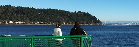 Photo of a couple on a ferry in the Kitsap Peninsula