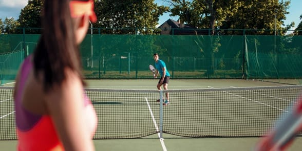 Photo of a couple playing tennis