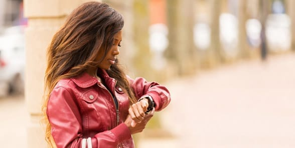 Photo of a woman looking at her watch