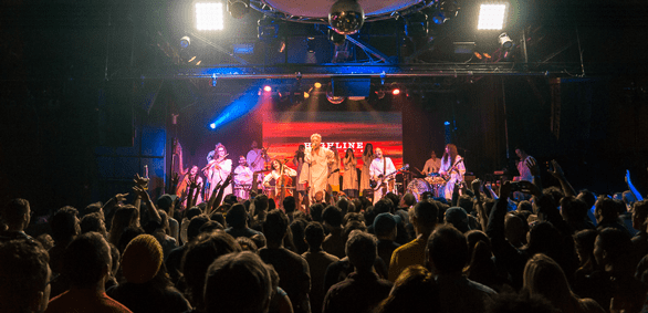 Photo of a Polyphonic Spree concert and the crowd