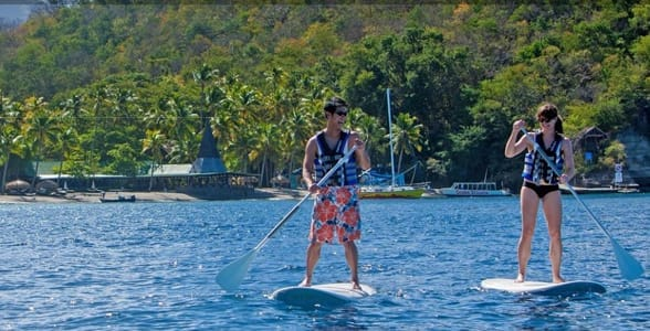 Photo of a couple stand-up paddleboarding