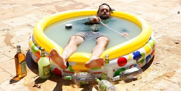 Photo of a man in a kiddie pool