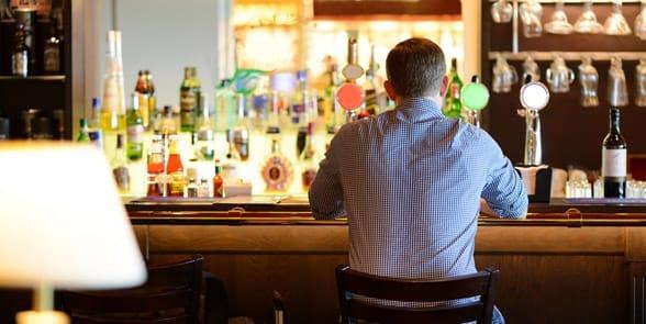 Photo of a man alone at a bar