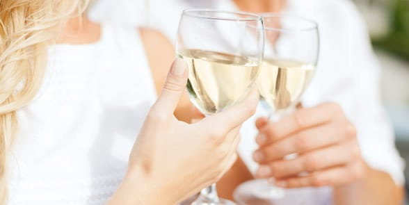 Photo of a couple clinking wine glasses