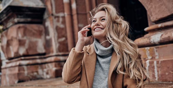 Photo of a woman smiling on the phone