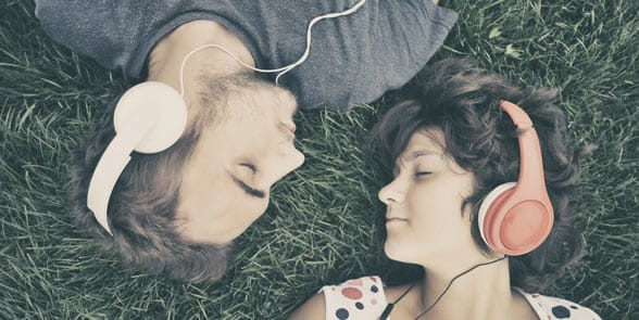 Photo of a couple listening to music