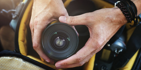 Photo of hands holding a camera