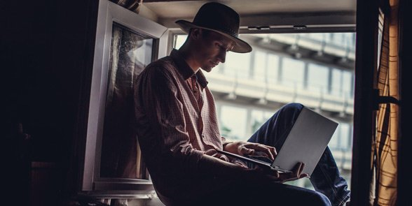 Photo of a man on a laptop