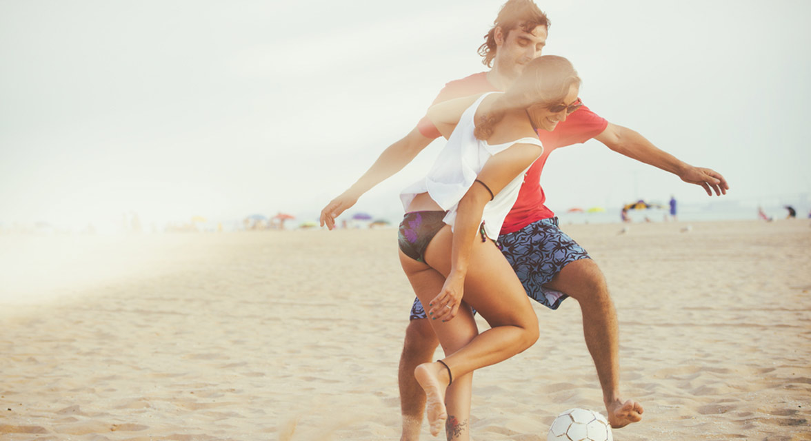 Photo of a couple playing soccer
