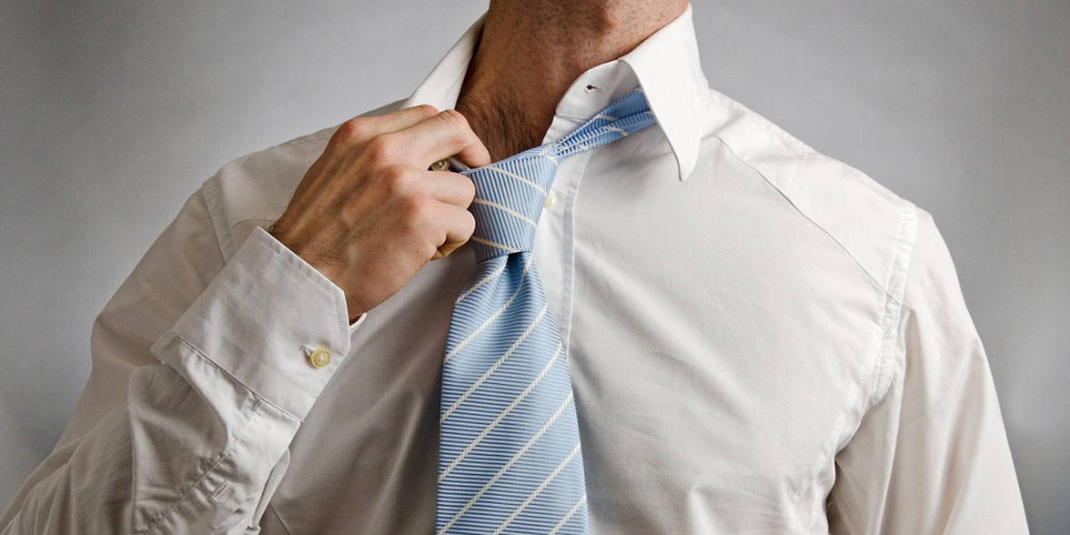 Photo of a man pulling on his collar